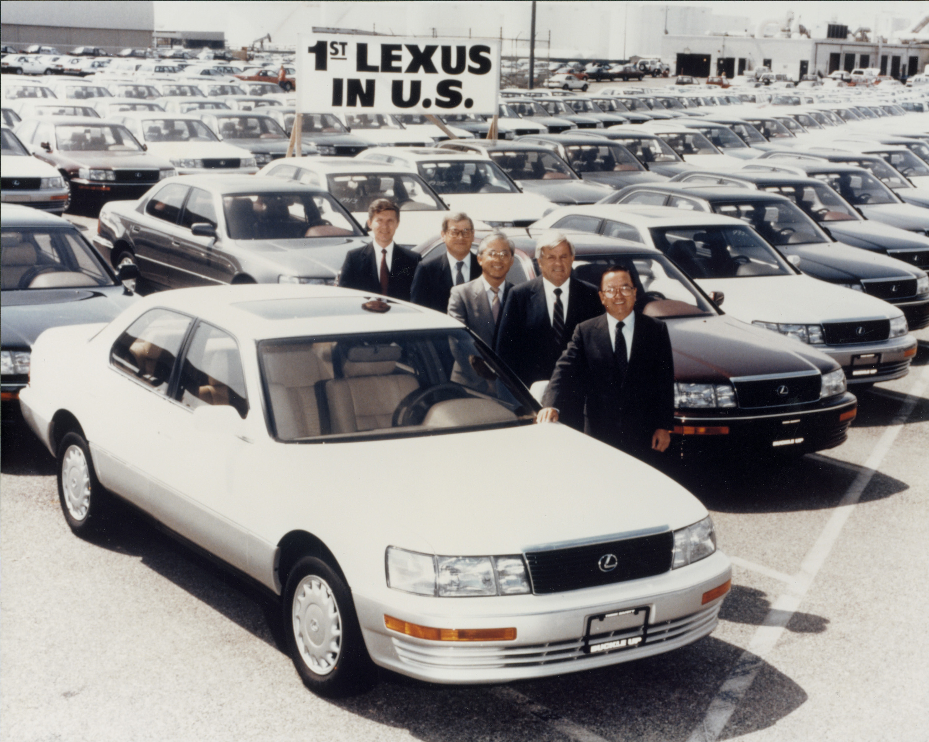 Toyota Executives Pose with the First Lexus Vehicle